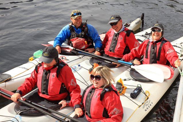 Group of kayakers in Doubtful Sound rafted together